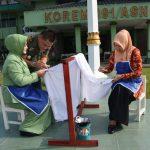 Pemecahan Rekor MURI Membatik dengan Canting di Makorem 091/ASN